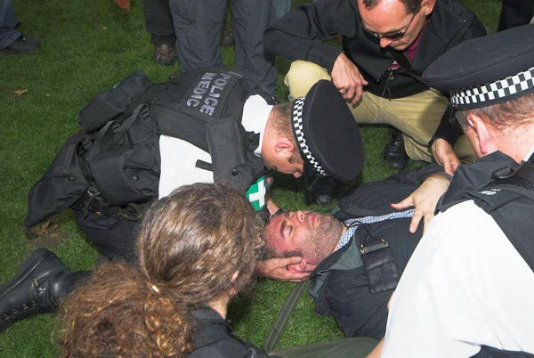 Police Medics treat Marc Vallee